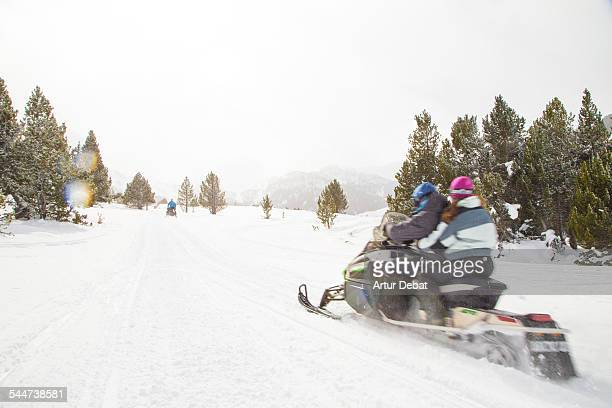 Couple in snowmobile in the Andorra Pyrenees.