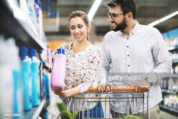 couple in supermarket. - cleaning agent stock pictures, royalty-free photos & images
