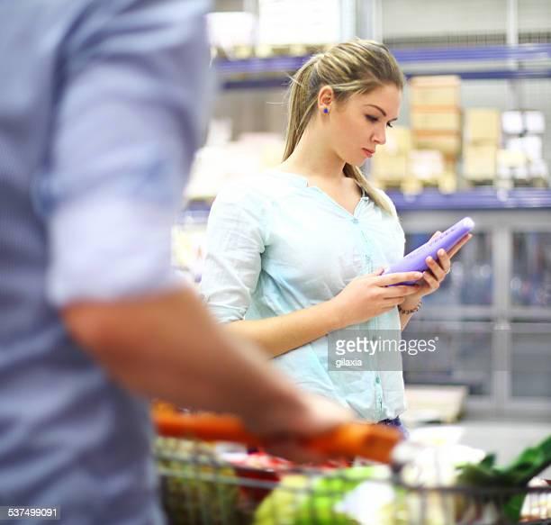 Couple in supermarket.