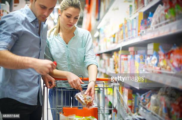 Couple in supermarket shopping together.