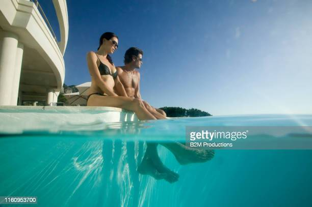 couple in swimming pool - 2010 2019 stock pictures, royalty-free photos & images