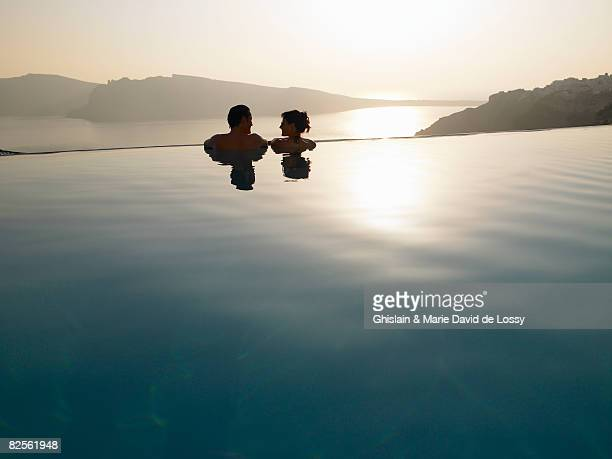 couple in swimming pool, sunset - tourist resort stock pictures, royalty-free photos & images