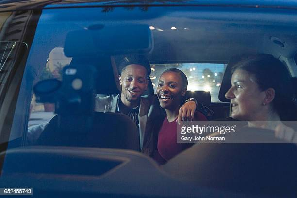couple in taxi booked with ride share app - car pooling stock photos and pictures