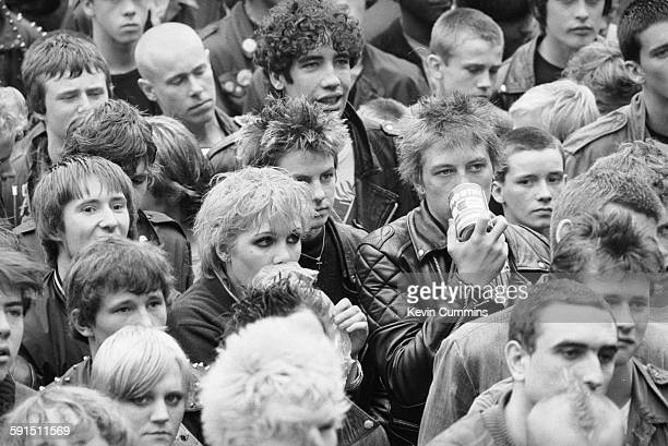 A couple in the audience sniffing glue at the Northern Carnival Against Missiles a festival in aid of CND held in Alexandra Park Manchester 8th...