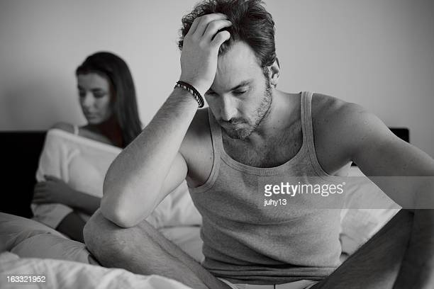 A couple in the bedroom after a fight