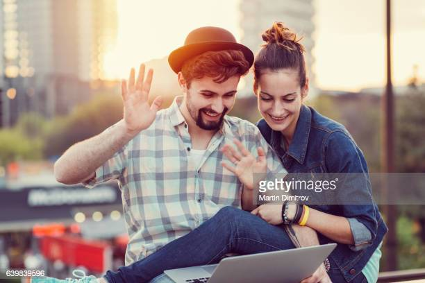 couple in the city enjoying a video call - very young webcam girls stock photos and pictures