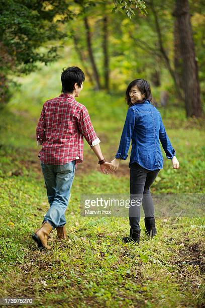 a couple in the forest - 中年カップル ストックフォトと画像