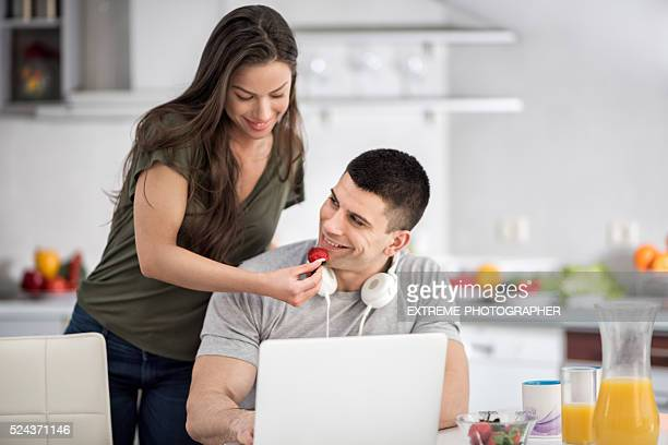 couple in the kitchen - mp3 juices stock photos and pictures