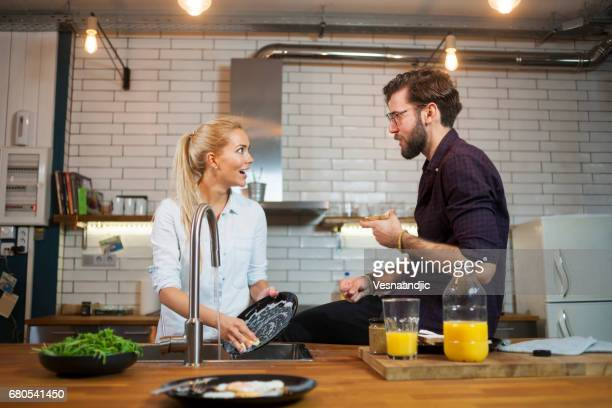 couple in the kitchen - couples showering stock pictures, royalty-free photos & images
