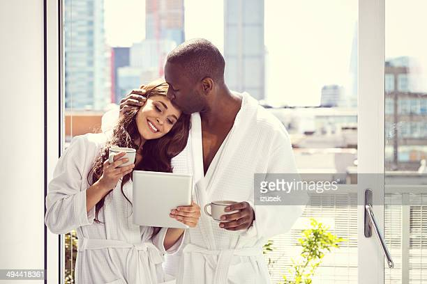 couple in the morning - women of penthouse stock photos and pictures