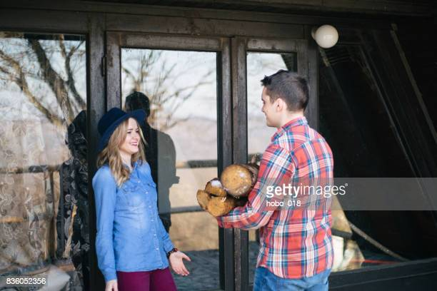 Couple in the mountain log cabin