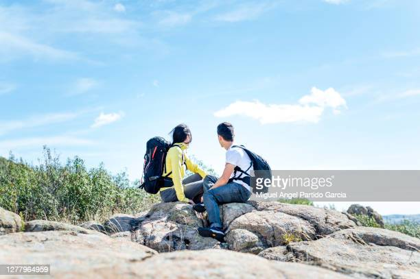 couple in the mountain looking at the views - madrid stock pictures, royalty-free photos & images