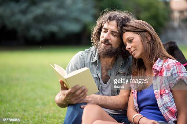 Couple in the park: Reading book