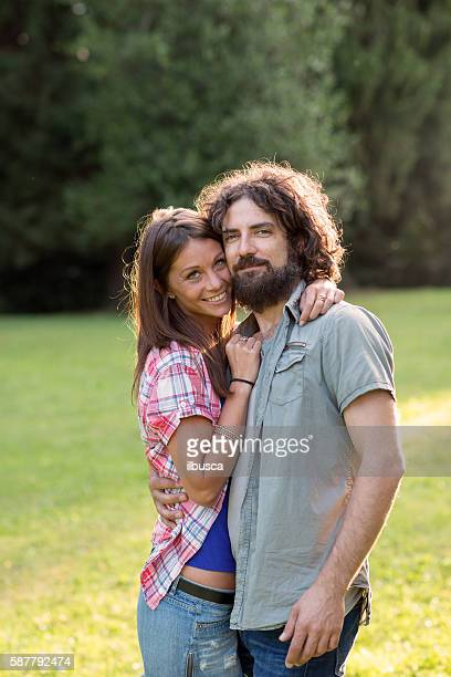 couple in the park: together in love - 30 39 years stock pictures, royalty-free photos & images