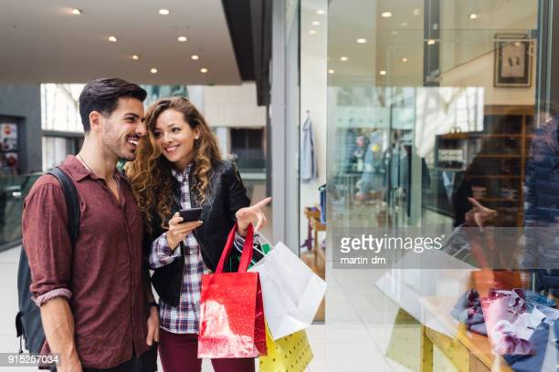 couple in the shopping center - shopping mall stock pictures, royalty-free photos & images