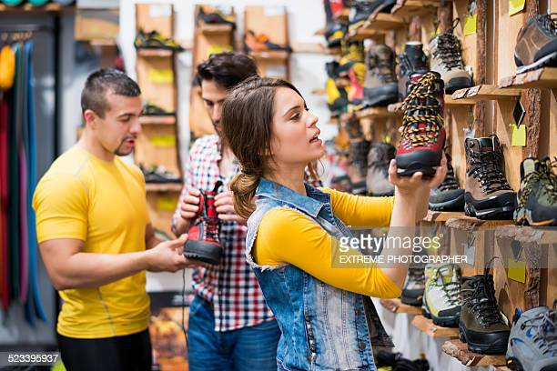 Couple in the store choosing hiking boots