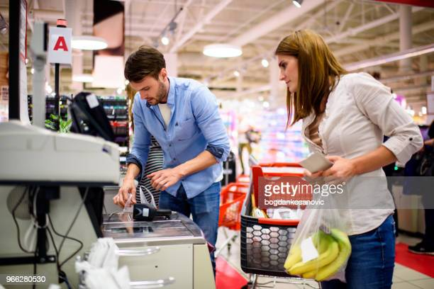 couple in the store - checkout stock pictures, royalty-free photos & images
