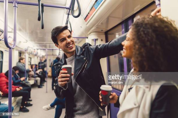 couple in the subway train - subway train stock pictures, royalty-free photos & images
