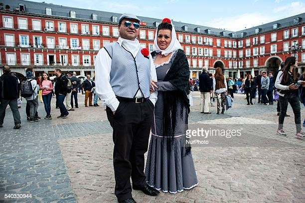 A couple in the typical suit of quotchulapoquot Madrid's Plaza Mayor perches on the occasion of the festival of San Isidro