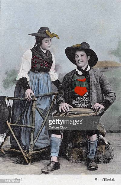 Couple in traditional costume Alt Zillertal Tyrol at time of Austro Hungarian Empire Man playing zither