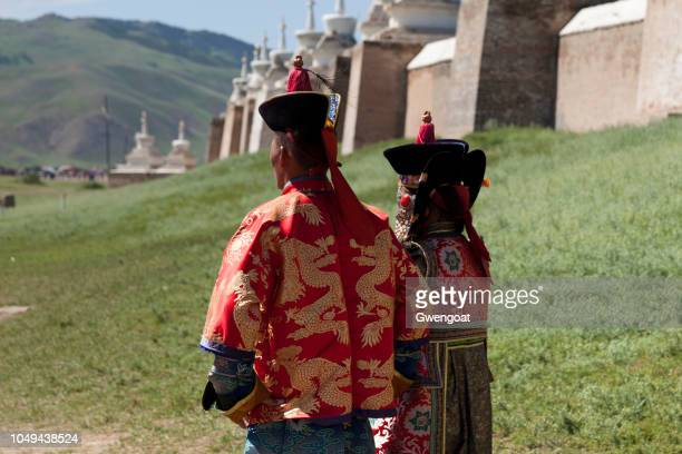 couple in traditional costume at erdene zuu monastery - traditional clothing stock pictures, royalty-free photos & images