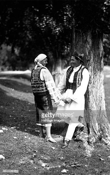 Couple in traditional costume, Bistrita Valley, Moldavia, north-east Romania, c1920-c1945. Depicting customs and traditional labour in the rural...