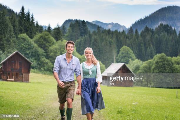 couple in traditional lederhosen and dirndl tracht, austria - traditional clothing stock pictures, royalty-free photos & images