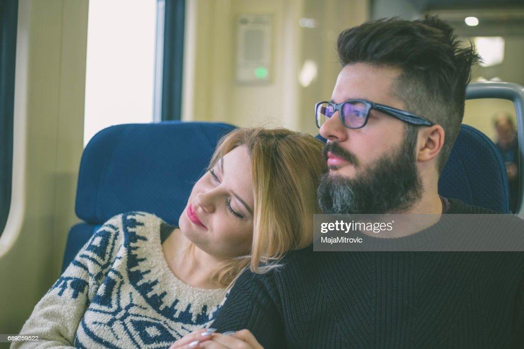 Couple in train : Stock Photo