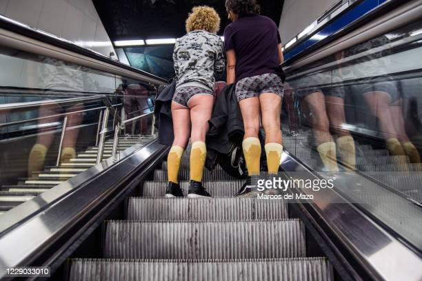 "Couple in underwear inside the metro during the annual ""No Pants Subway Ride""."
