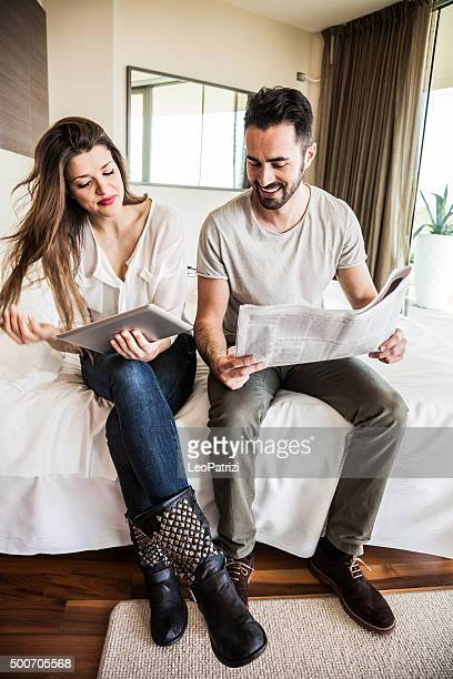 Couple in vacation reading news in the morning