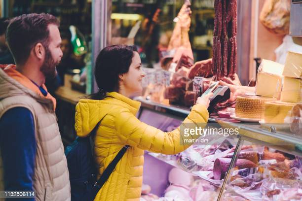 couple in valencia shopping at the farmer's market - homegrown produce stock pictures, royalty-free photos & images