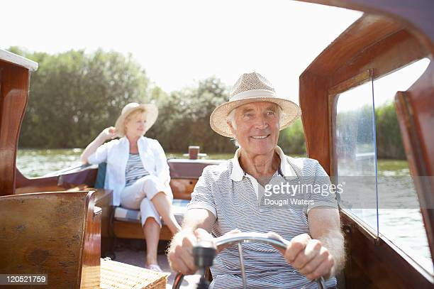 Couple in vintage boat.