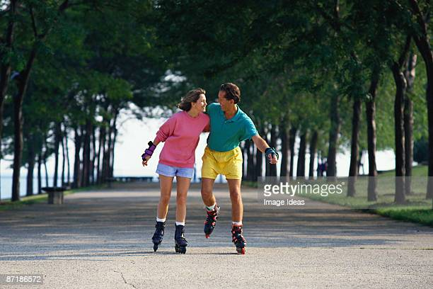Couple in-line skating outdoor