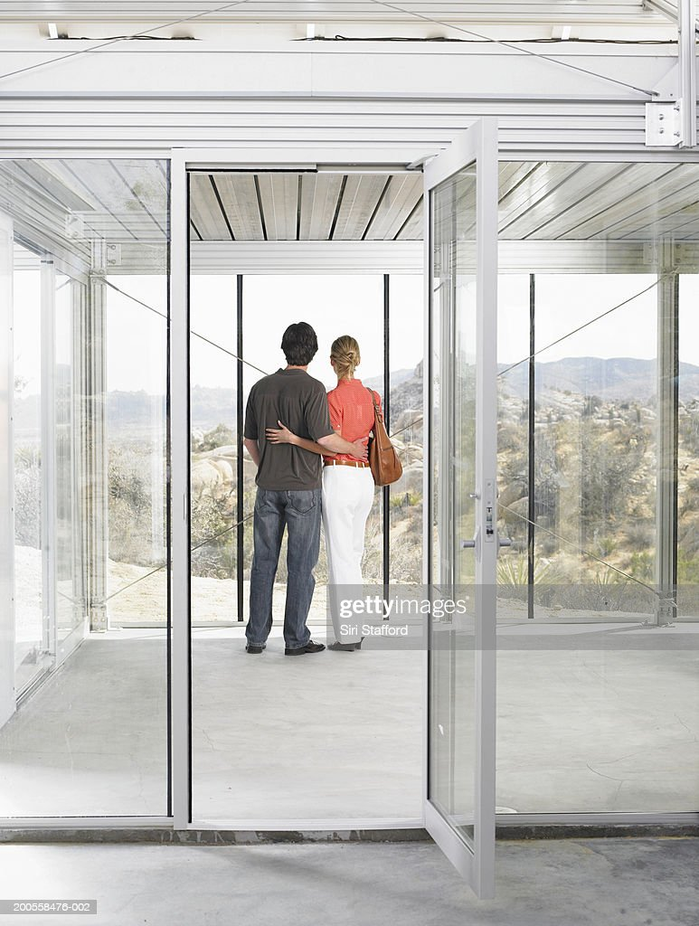 Couple inside prefabricated home under construction : Stock Photo