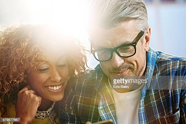 Couple interacting with a mobile phone.