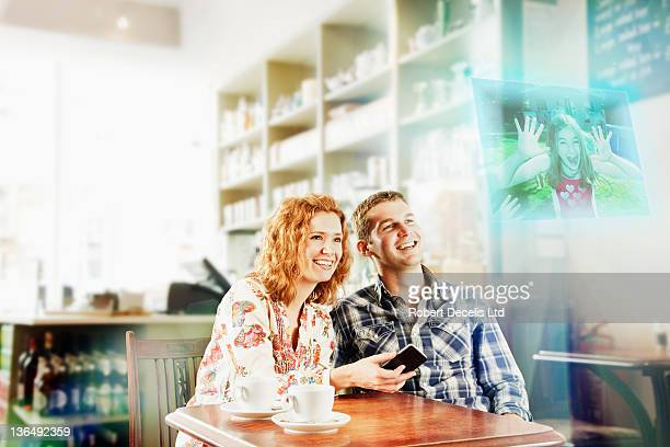 Couple interating with child on smart phone