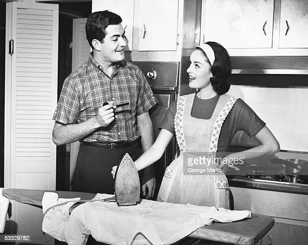 couple ironing - stay at home mother stock pictures, royalty-free photos & images