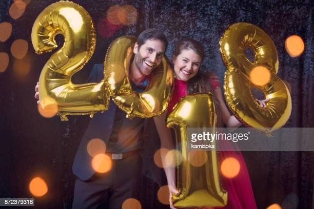 Couple is celebrating New year with ballon '2018'