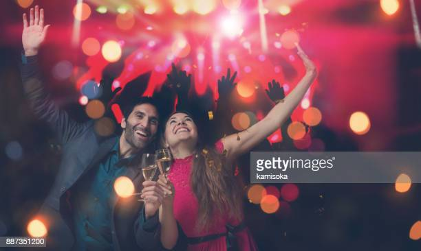 Couple is celebrating new year's eve at a party