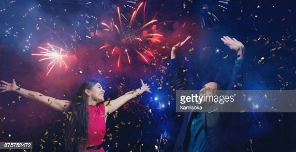 Couple is celebrating new year's eve under fireworks