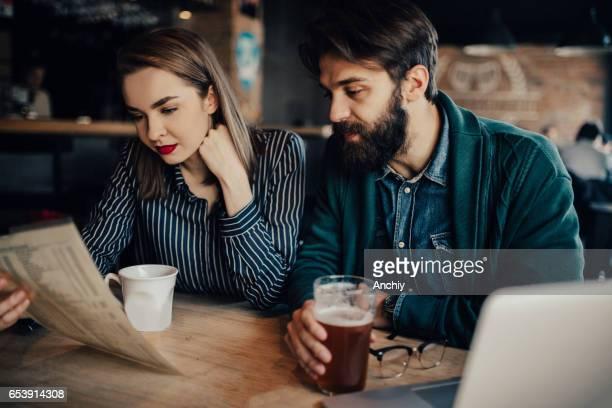 Couple is choosing food from the menu