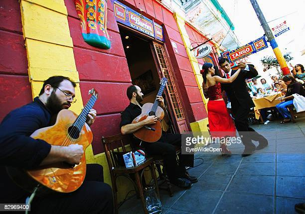 Couple is dancing the traditional dance Tango in front of a restaurant in La Boca district on January 13 2008 in Buenos Aires Argentina The Republic...