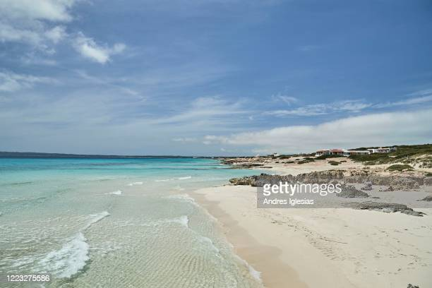 A couple is enjoying the sun at Migjorn beach on May 06 2020 in Formentera Spain Among its 12000 inhabitants currently registered there have been...