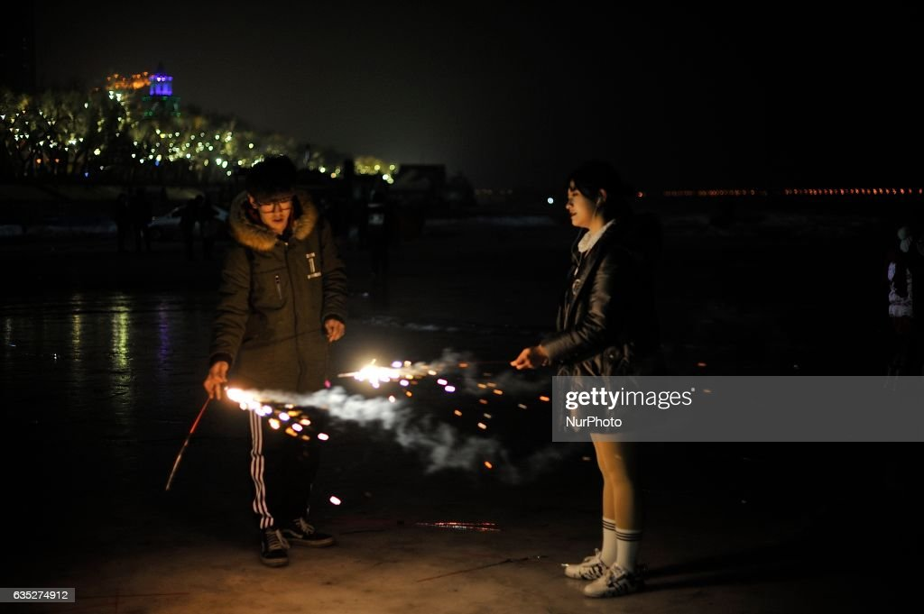 A couple is firework to mark Valentine's Day at Songhuajiang River in Harbin city of China on 14 February 2017.Many Chinese couples choose Valentine's Day to celebrate love as the western Valentine's Day becomes more and more popular among young people in China.