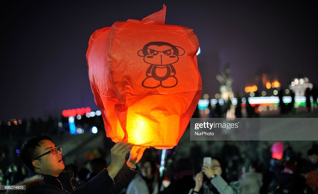 A couple is flying Kongming lantern to mark Valentine's Day at Songhuajiang River in Harbin city of China on 14 February 2017.Many Chinese couples choose Valentine's Day to celebrate love as the western Valentine's Day becomes more and more popular among young people in China.