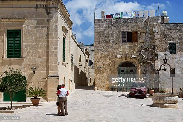 CONTENT] A couple is having a romantic moment in a scenery of a picturesque Mdina This square in the middle of the historic 'silent city' reminds me...