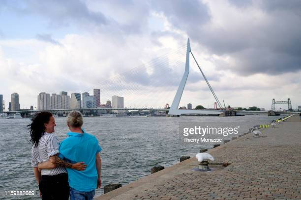 A couple is looking at the 'Erasmus Bridge' on August 2 2019 in Rotterdam Netherlands The Erasmusbrug was designed by Ben van Berkel and is a...