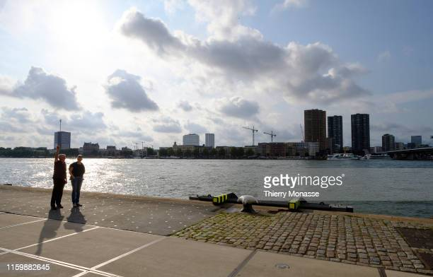 A couple is looking at the Meuse river on August 2 2019 in Rotterdam Netherlands
