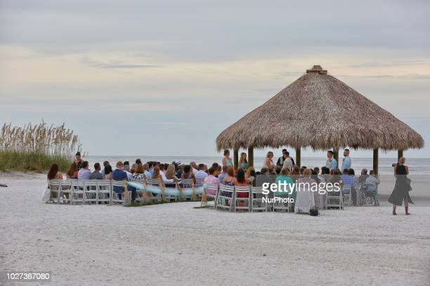Couple is married under a gazebo during a beach wedding on the beautiful San Marco Beach on Marco Island Florida USA on August 30 2018