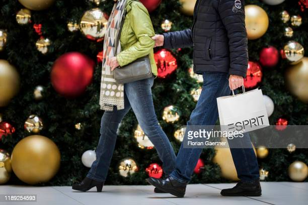 Couple is pictured in a shopping mall in front of a christmas tree on December 17, 2019 in Berlin, Germany.